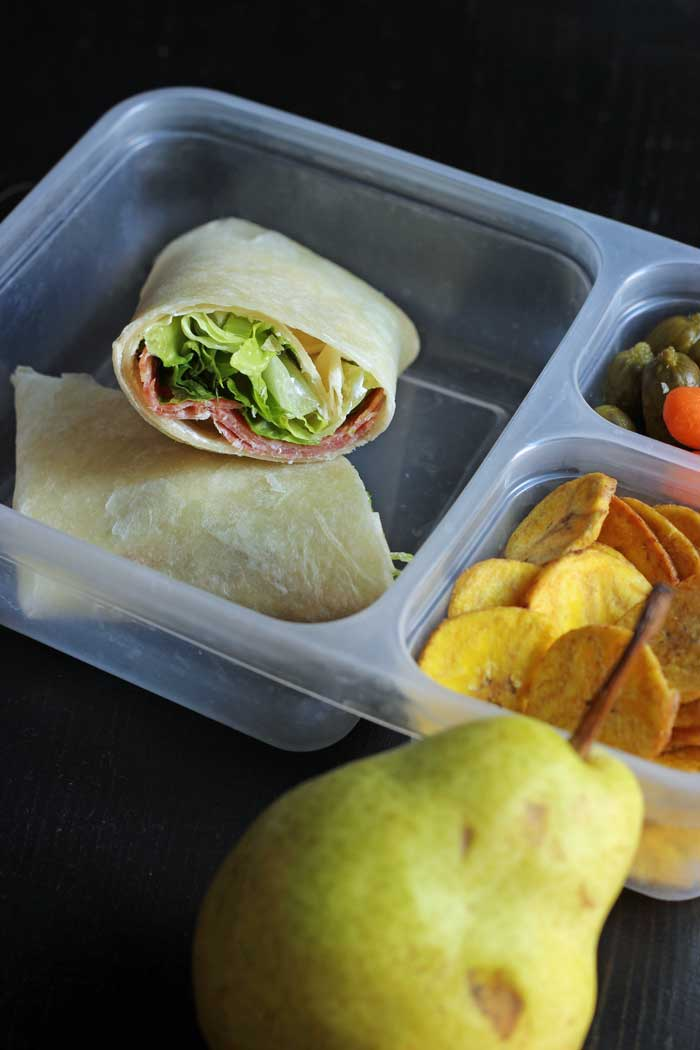 child's bento box with wrap, plantain chips, and pear