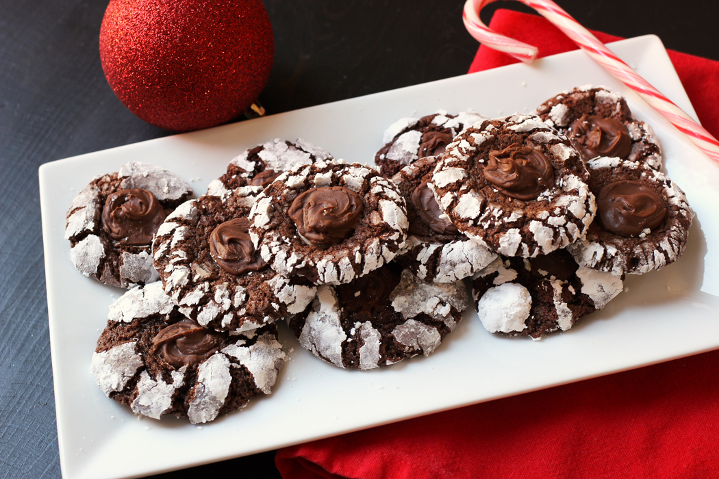 Chocolate Crinkle Cookieson plate with candy cane and ornament
