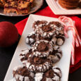 plate of Chocolate Crinkle Cookies with plates of other cookies