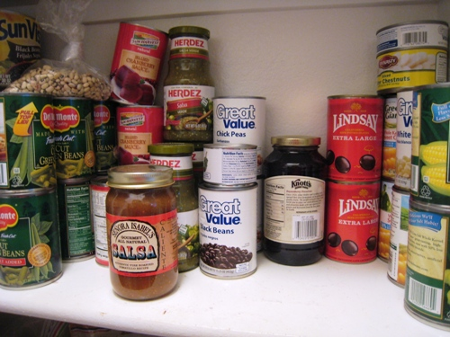 pantry shelf of canned goods