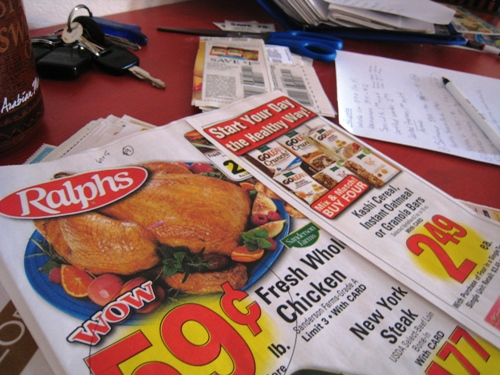grocery ads and coupons on table