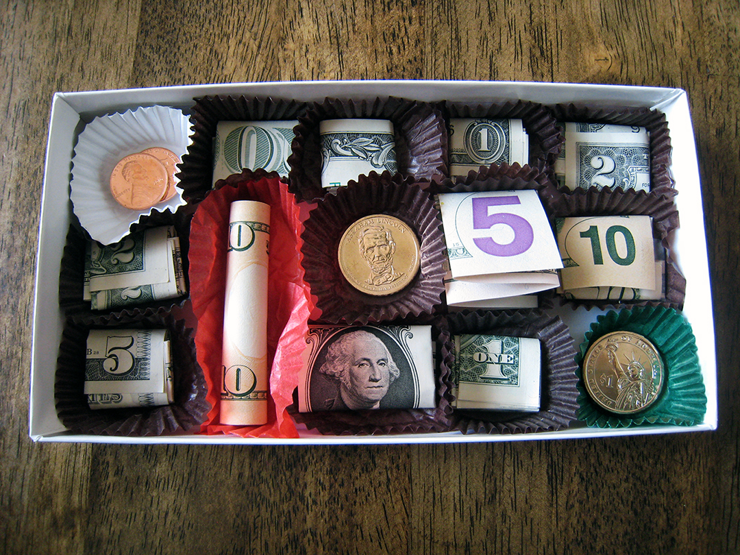 chocolate box with money of different denominations