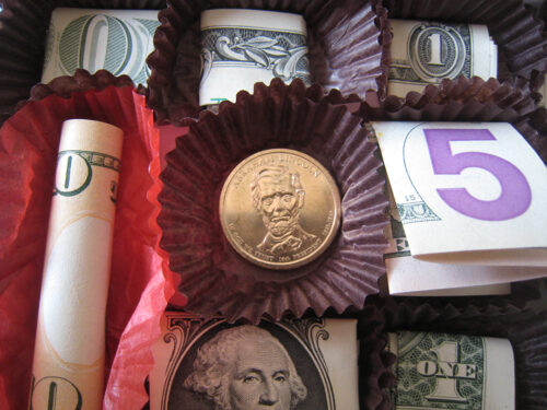 coins and bills in liners in chocolate box