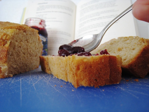 a slice of bread and jam with cookbook