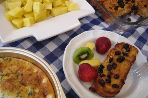 Breakfast table set with fruit and french toast