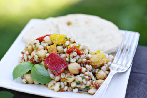 A plate of bean salad and pita bread
