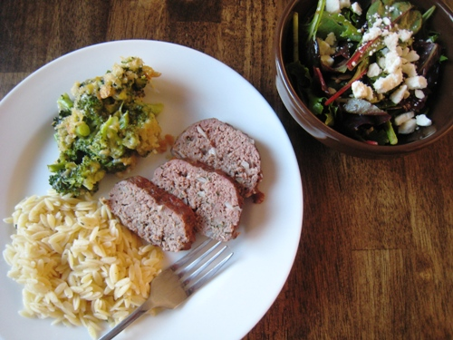 A plate of with Meatloaf and side dishes