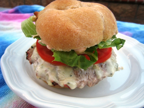 A close up of a cheeseburger