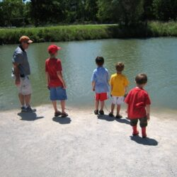 boys and papa at pond