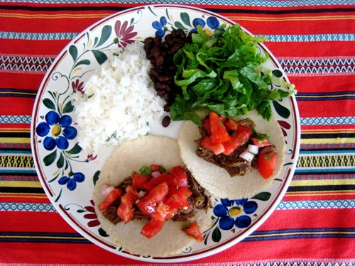A plate of beef tacos and rice