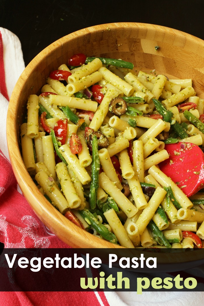 A bowl filled with vegetable pesto pasta salad