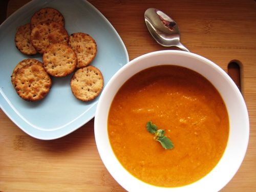 A bowl of Vegetable soup, with crackers