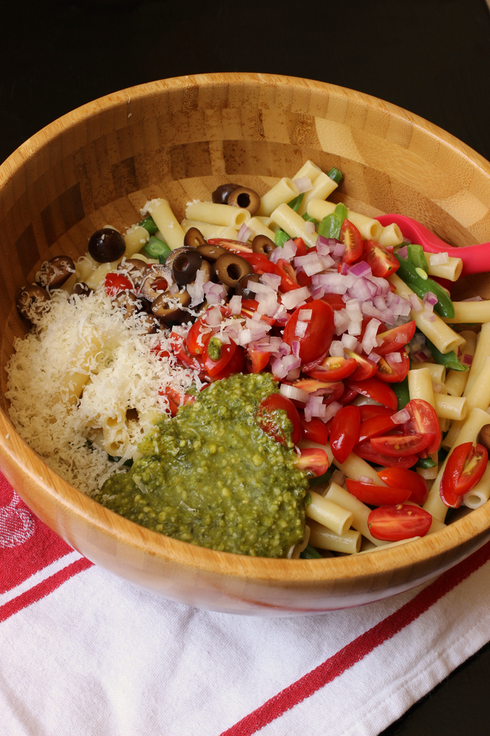 close up of ingredients for vegetable pesto pasta salad