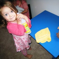 toddler wiping the table