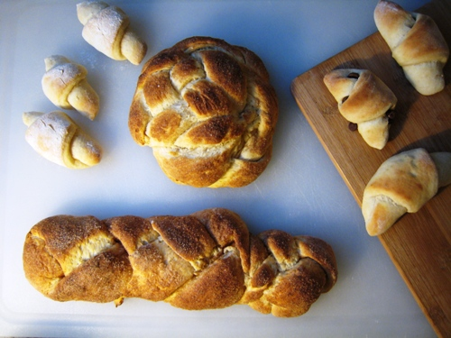 four breads made with one dough on a cutting board