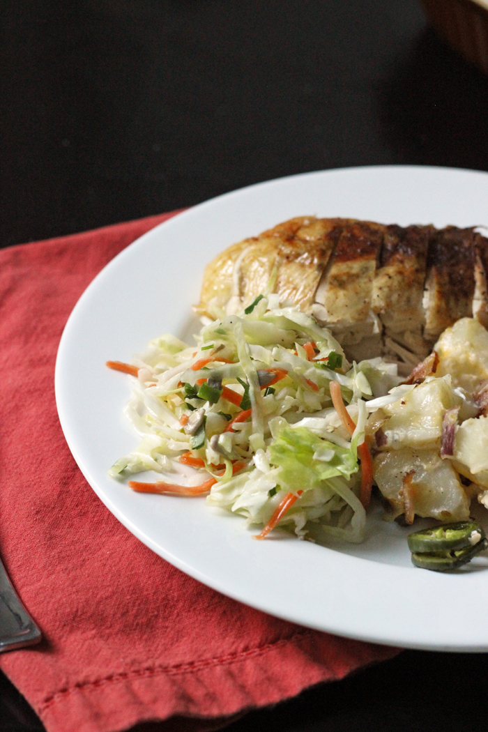 dinner plate with chicken, potatoes, and coleslaw