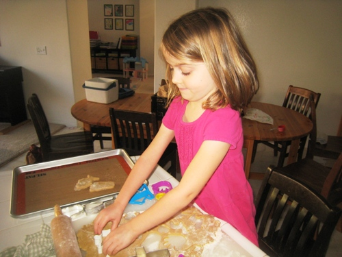 girl cutting out cookies