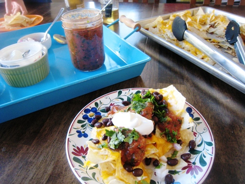 plates of food on a table, with Nachos