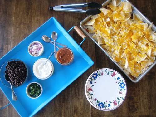 A tray of food on a table, with Nachos