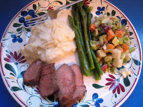 A plate with Tri-tip and vegetables