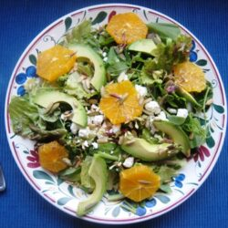 orange and avocado salad with pea tendrils