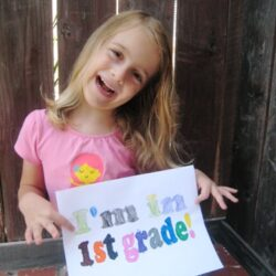 girl in first grade with sign