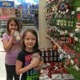 girls looking at christmas ornaments at target