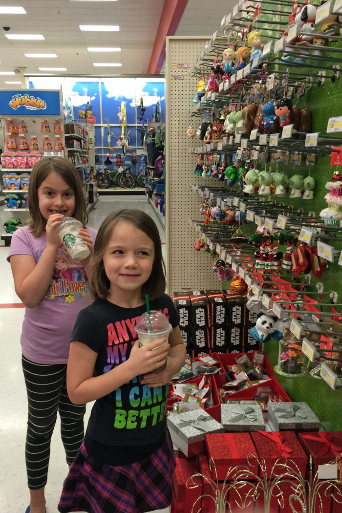 girls looking at christmas ornaments at target