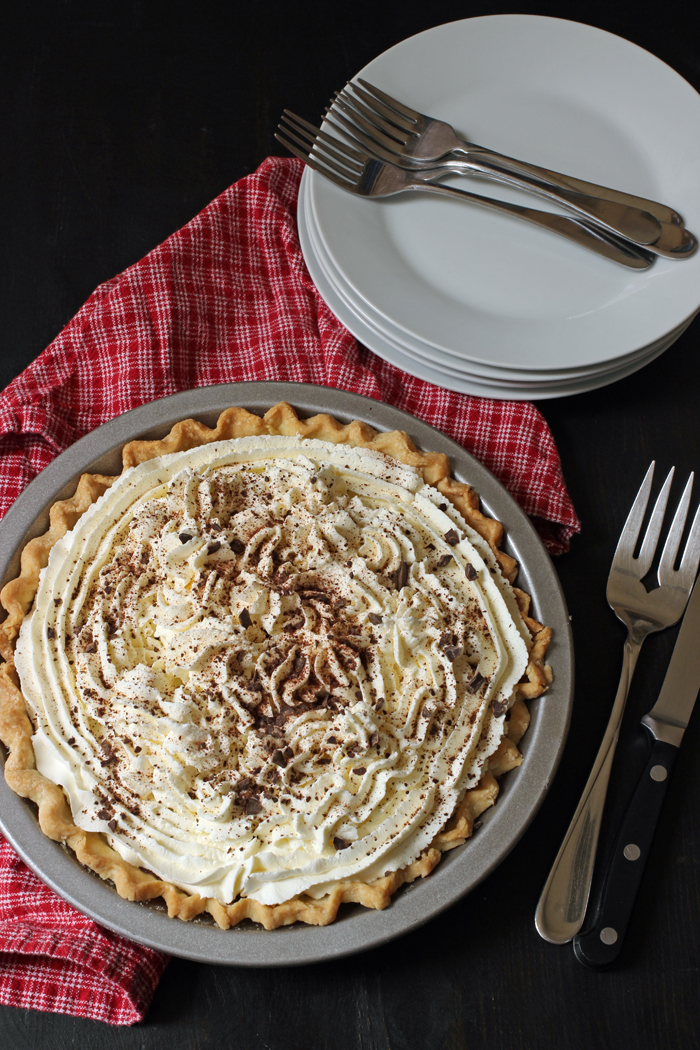 entire Chocolate Cream Pie with plates and forks