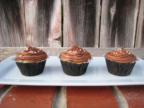 cupcakes on a tray on brick wall