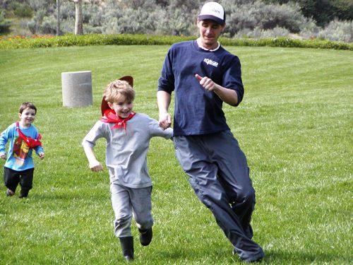boys chasing in field