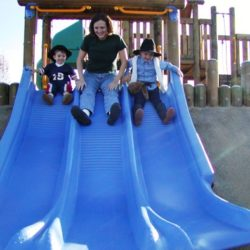 mom and boys on slide