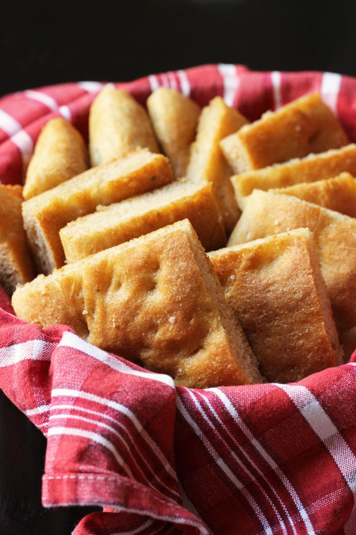 A basket of focaccia squares