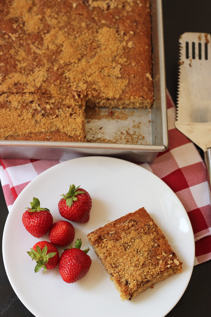 metal pan of coffeecake with plate of coffeecake and strawberries