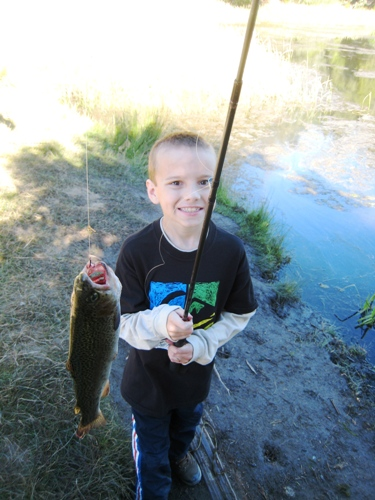 fishing boy with pole