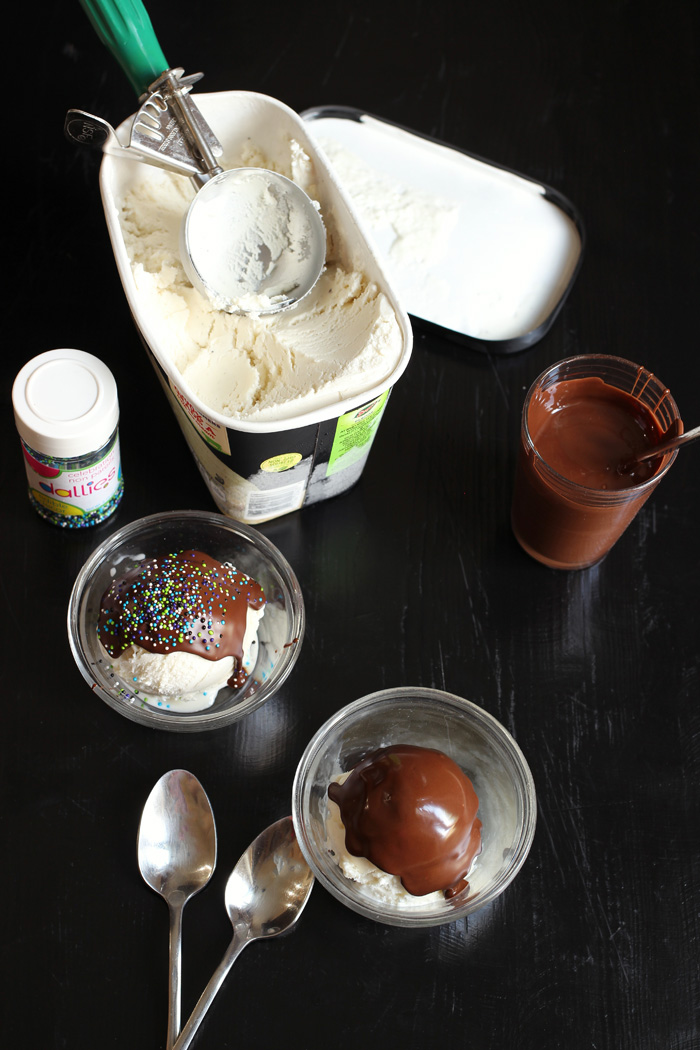 ice cream carton, magic shell, sprinkles, and two dishes of ice cream