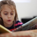 girl learning to read