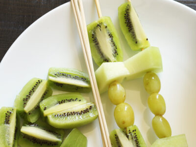 green fruit kabobs on plate