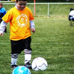 boy with soccer balls