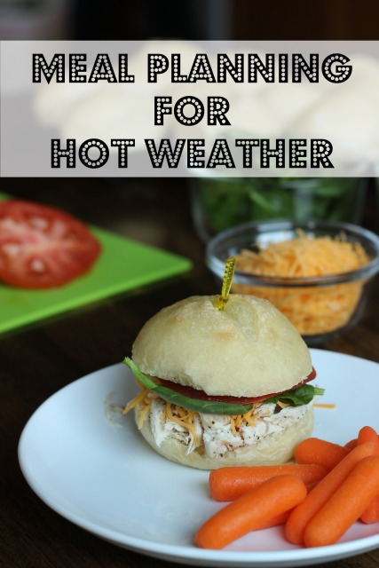 chicken sandwich on plate with carrots