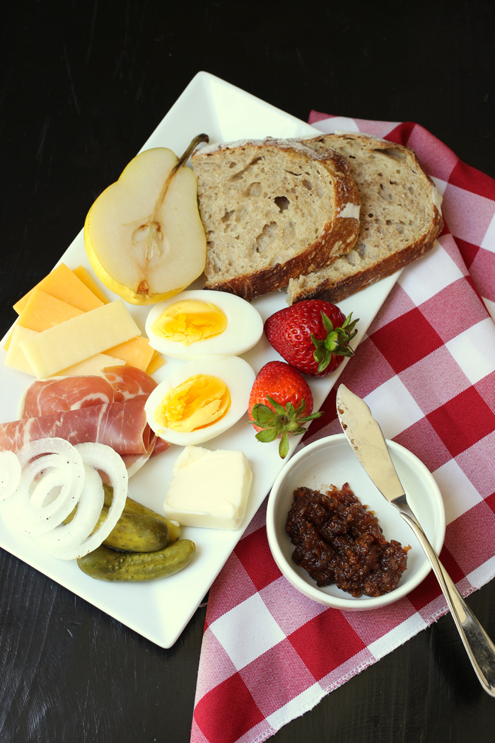 A plate of food with Cheese and Ploughman\'s lunch
