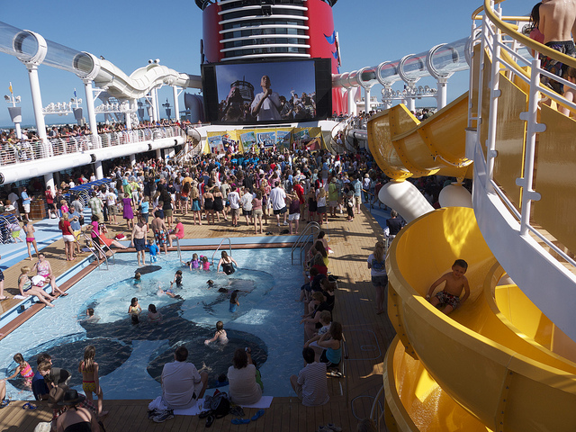 Cruising with Kids - Are you considering taking a family cruise? Life as MOM contributor JessieLeigh has some tips to planning a trip the whole family will love.