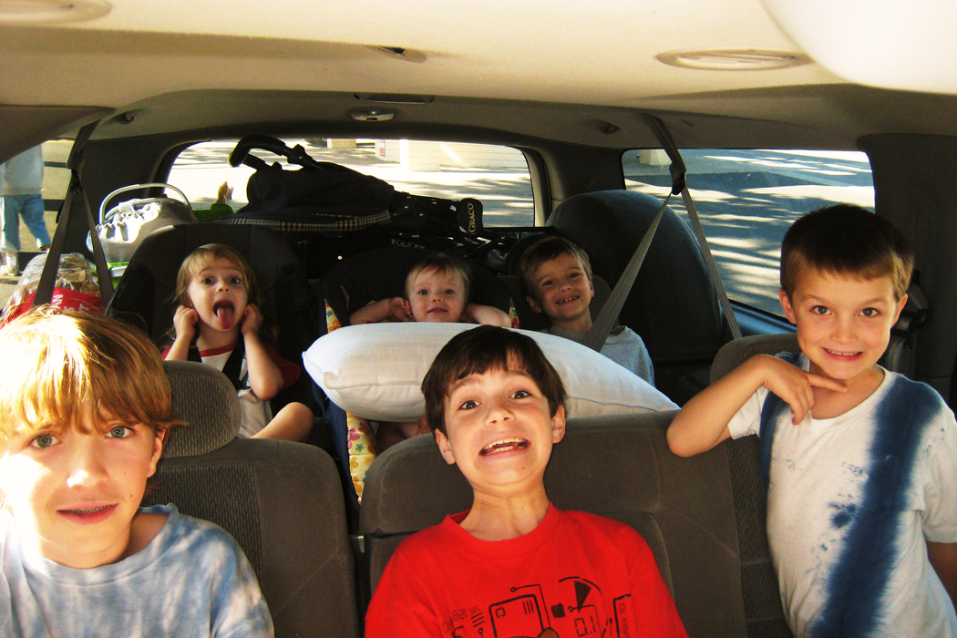 kids packed in car road trip