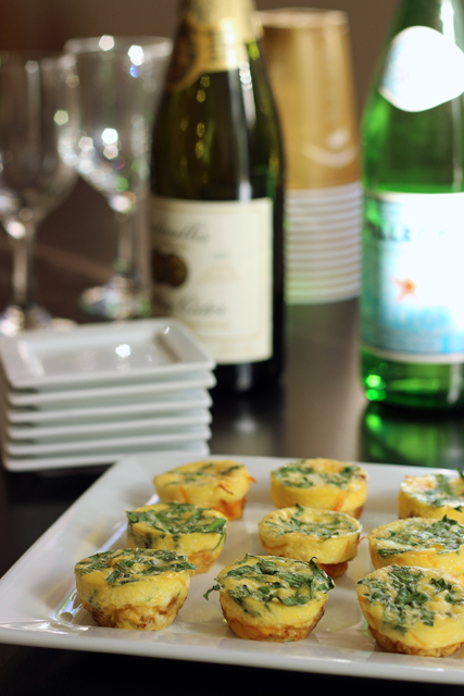 Bacon and Spinach Frittata Bites - Want to bring something tasty and filling to your next party? These Bacon and Spinach Frittata Bites are just the cocktail snack to prepare. Check out this round-up of finger foods from holiday sweets to savory treats.