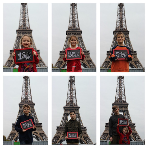 kids at eiffel tower with grade level signs
