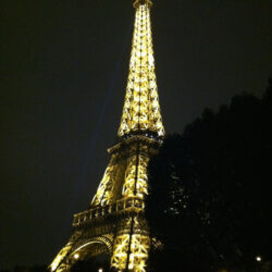eiffel tower at night lit paris