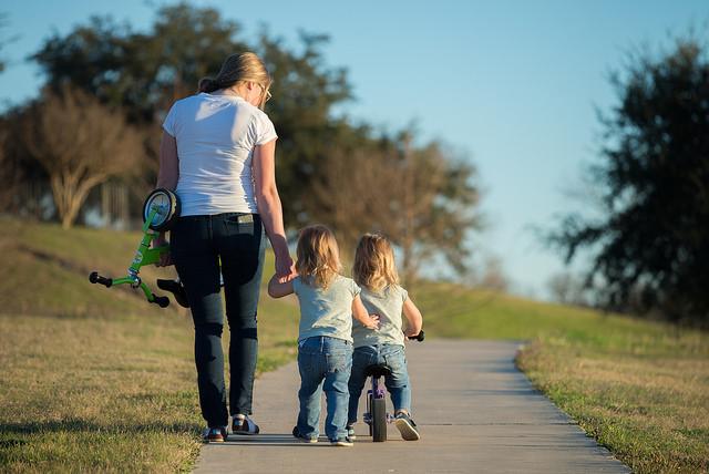 mom girls on bike credit donnie ray jones