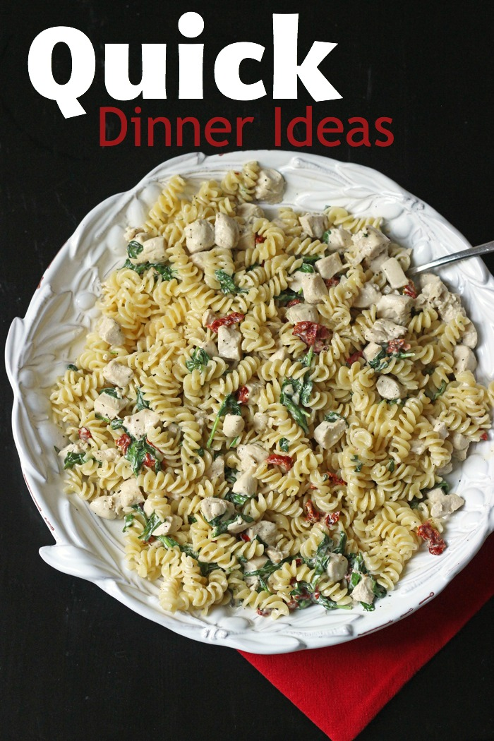 bowl of pasta noodles with chicken and spinach