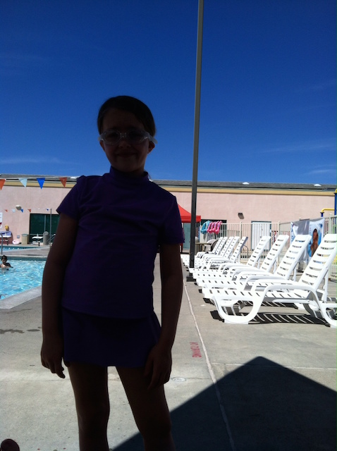 girl silhouette at pool