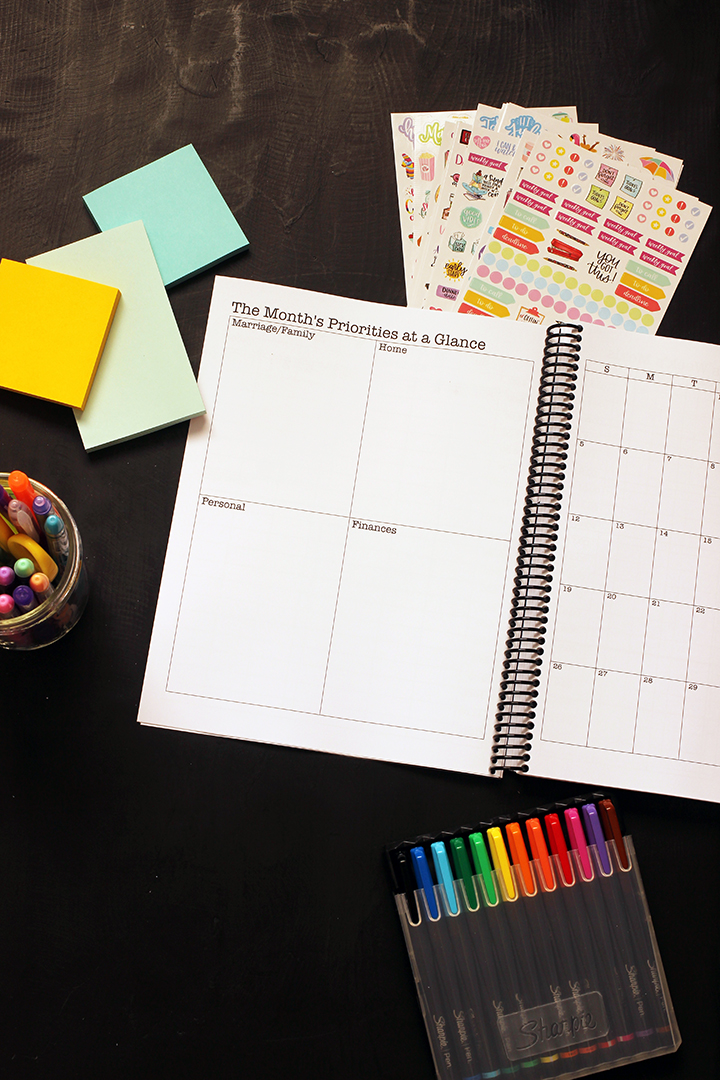 blank planner opened to monthly priority page